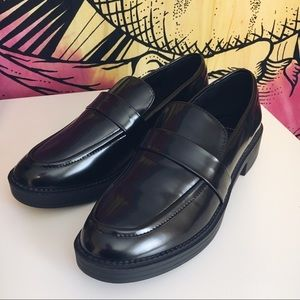 Truffle Collection black loafers